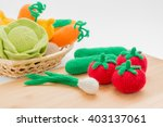 knitted vegetables on a cutting ...