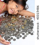 happy asian girl with coins - stock photo