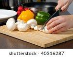 woman hands slices mushrooms in ... | Shutterstock . vector #40316287