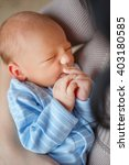 infant. a woman holds in her... | Shutterstock . vector #403180585
