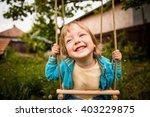Joyous Child Swinging On Seesa...