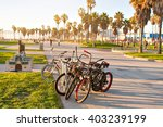 bicycles on venice beach in los ... | Shutterstock . vector #403239199