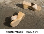 A Dilapidated Pair Of Woman's...