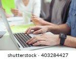 cheerful creative team is using ...   Shutterstock . vector #403284427
