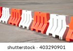 red and white plastic barriers...   Shutterstock . vector #403290901