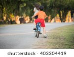 young asian boy ride a bicycle... | Shutterstock . vector #403304419