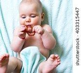 Beautiful Baby Girl Chewing...