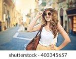 happy tourist in the city | Shutterstock . vector #403345657