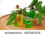 bottles of tea oil on wooden... | Shutterstock . vector #403362019