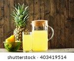pineapple slices and juice in... | Shutterstock . vector #403419514