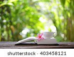 notebook with flower and cup on ... | Shutterstock . vector #403458121