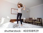 Carefree Girl Jumps On The Bed...