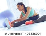 staying flexible. young... | Shutterstock . vector #403536004