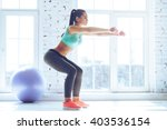 deep squat. side view of young... | Shutterstock . vector #403536154