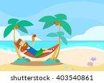 Man Lying In Hammock Beach...