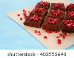 chocolate brownies with garnet. | Shutterstock . vector #403553641
