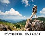 tourist on the peak of high...   Shutterstock . vector #403615645