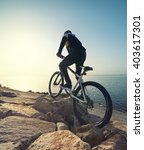 ride on bike on the beach....   Shutterstock . vector #403617301