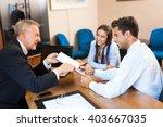 senior businessman showing a... | Shutterstock . vector #403667035