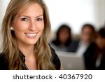 Business woman portrait smiling in an office - stock photo