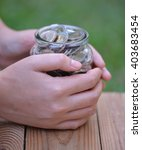 Women Hold Money Jar With Coins ...