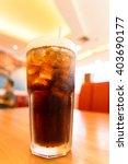 cola on ice | Shutterstock . vector #403690177