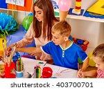 happy children and teacher draw ... | Shutterstock . vector #403700701