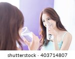 portrait of young woman drink... | Shutterstock . vector #403714807