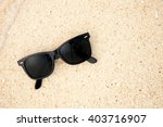 top view of sunglasses on the... | Shutterstock . vector #403716907
