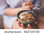 Young Woman With Muesli Bowl....