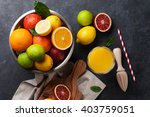 fresh ripe citruses and juice.... | Shutterstock . vector #403759051