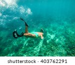 boy snorkeling in thailand   Shutterstock . vector #403762291