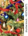 toys on green christmas fir | Shutterstock . vector #403763071