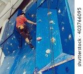fit man rock climbing indoors... | Shutterstock . vector #403766095