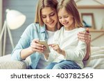 beautiful young mom and her... | Shutterstock . vector #403782565