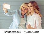 portrait of beautiful mature...   Shutterstock . vector #403800385