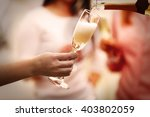 Pouring Champagne Into Glass A...