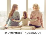 back view of three generations... | Shutterstock . vector #403802707
