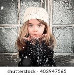 a young child is blowing white... | Shutterstock . vector #403947565