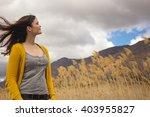 beautiful young woman enjoys a... | Shutterstock . vector #403955827