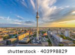 Stock photo aerial wide angle view of berlin skyline with famous tv tower at alexanderplatz and dramatic clouds 403998829