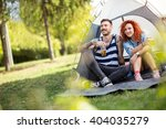 Young Couple In Front Of Tent...