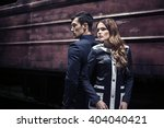 a man and woman back to back | Shutterstock . vector #404040421