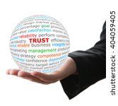 Small photo of Trust concept. Hand take white ball with trust word in red color.
