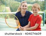 female tennis coach giving... | Shutterstock . vector #404074609