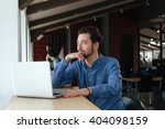 pensive man sitting at the... | Shutterstock . vector #404098159