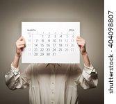 woman is holding march calendar ... | Shutterstock . vector #404098807