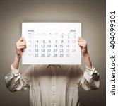 woman is holding april calendar ...   Shutterstock . vector #404099101