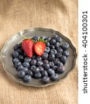 Small photo of Strawberries and Blueberries on a vintage pewter plate