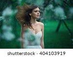 girl on a green background | Shutterstock . vector #404103919